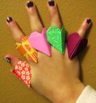 Closeup of origami heart rings