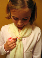 Photo of Sarah and her origami heart scarf holder