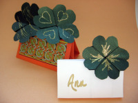 origami-4-leaf-clovers in display stands