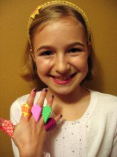 Photo of Sarah and her five origami heart rings