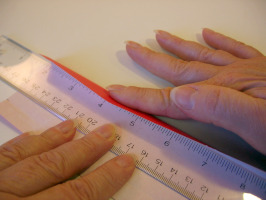 Using a ruler to help with a fold