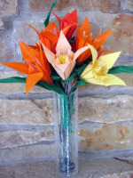 Origami lilies in vase